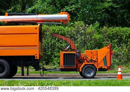 Wood Chipper Machine Releasing The Shredded Woods Into A Truck Tree Trim