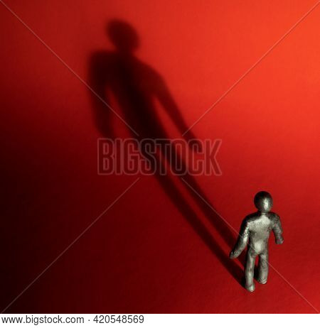 Psychology Or Religion Concept - Highlighted Clay Character Standing And Looking On Spotlight With D