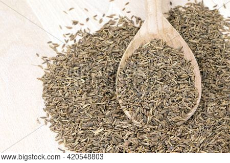 Cumin In A Wooden Spoon Wooden On A White Background. Caraway Seeds.