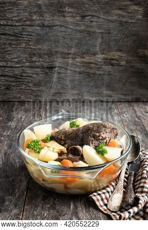 Lamb  Half Leg Stew With Vegetables In Glass Pot On Wooden Table