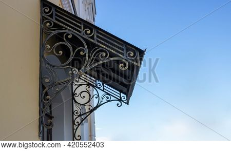 Old Wrought Iron Awning Over The Door Of An Old House.