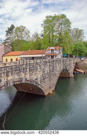 Montenegro, National Park Lake Skadar. Old Arched Bridge In Tourist Village Virpazar, Spring