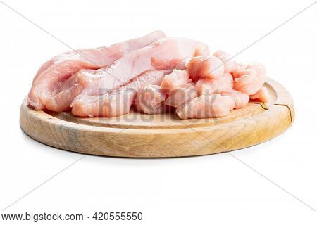 Poultry meat. Sliced raw turkey meat. Breast meat isolated on white background.