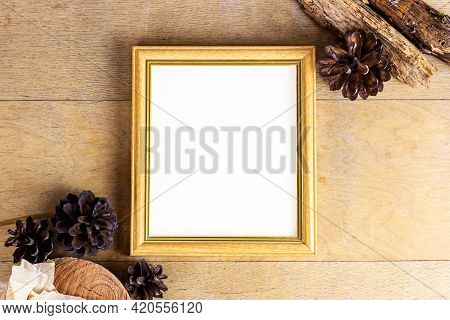 Top View Of Retro Empty Photo Frame With Natural Decorations, Branches And Cones On Wooden Backgroun