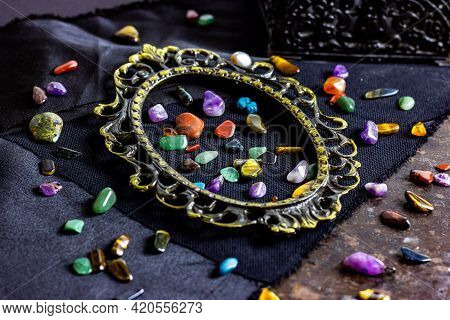 Different Colorful Gemstones In A Frame On Dark Background. Stone Therapy, Spiritual Healing, Crysta