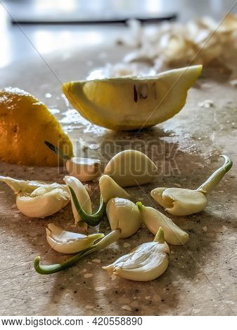 Peeled And Ready Garlic On Table Ready For Dinner