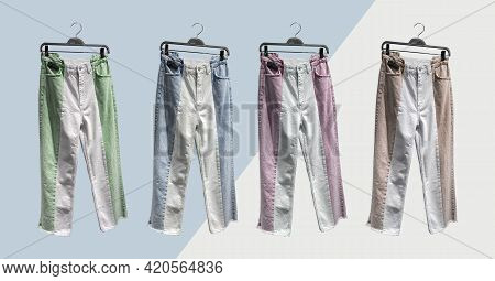 Two-tone Straight Fit Jeans With Pockets On Hangers. Jeans Front Top View. Collage Of Fashionable Cl