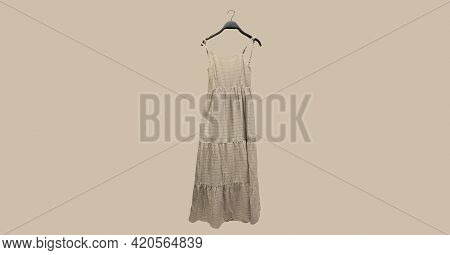 Beige Panelled Strappy Midi Dresses On Hanger. Composition Of Clothes. Collage Sale Clothes Banner.
