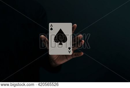 Ace Spade Playing Card. Player Or Magician Levitating Poker Card On Hand. Front View. Closeup And Da