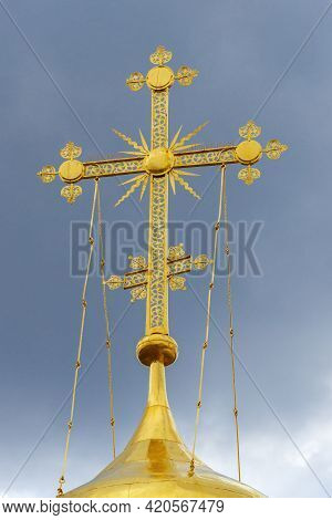 A Cross On The Dome Of Trinity Cathedral Against A Cloud Sky. Holy Trinity St. Sergius Lavra, Sergie