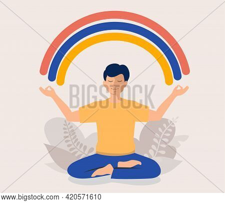 Happy Man Sits In Lotus Pose And Meditating. He Opened His Hands To The Rainbow. Guy Creates Good Vi