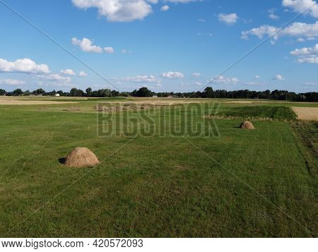 Haystack On A Farm Field On A Sunny Summer Day, View From The Top. Farm Land, Landscape From A Bird'