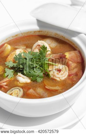 Thai Tom Yum Kung Spicy And Sour Shrimp Soup On White Table Background In Phuket Thailand