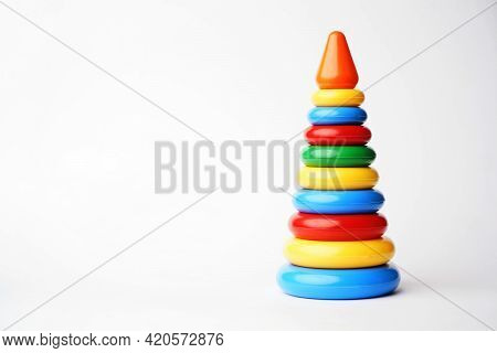 Baby Pyramid Toy On A White Background With Copy Space