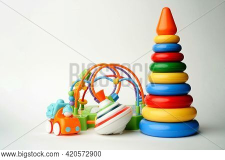 Baby Toys Collection On White Background With Copy Space