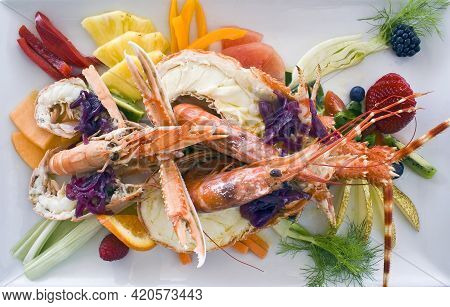 Catalan Lobster Dish With Vegetables And Fruits