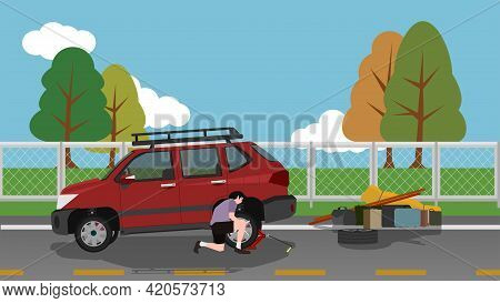 A Man Changes A Spare Tire On A Motorway. Use A Jack To Pry The Car Up. Take All The Luggage Off The