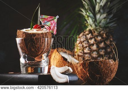 Pina Colada Summer Cocktail In Chopped Coconut With Tropical Fruits And Copper Bar Tools, Copy Space