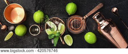 Moscow Mule. Preparation Cocktail  With Ginger Beer, Vodka, Lime And Ice. Copper Bar Tools. Black Ba