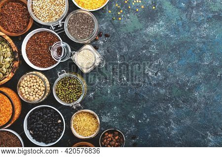Various Organic Superfoods, Beans, Grains, Cereals, Legumes, Seeds In Reusable Cans And Jars. Copy S