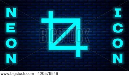 Glowing Neon Picture Crop Photo Icon Isolated On Brick Wall Background. Vector