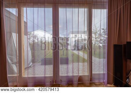 Beautiful View From Windows House Of Private Garden. Summer Grass Lawn, Peony Bush, Apple Tree, Cher