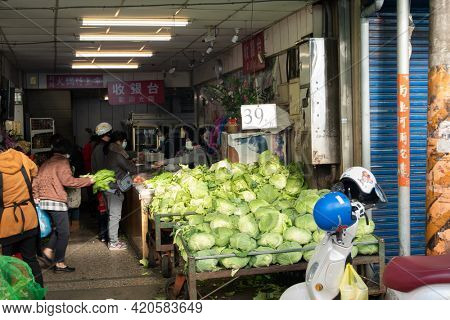 Taichung, Taiwan - Jan 13th, 2021: vegetable and fruits marketplace with vendor and people shop at Puli town, Nantou, Taiwan