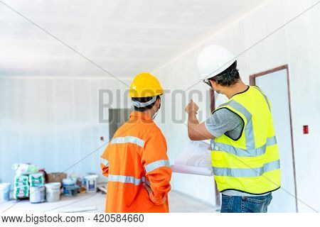 Architect And Engineer With Foreman Inspect Housing Estate Building To Success Construction Plan Bef