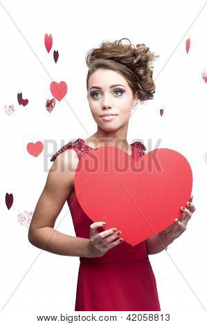 young cheerful woman holding red paper heart