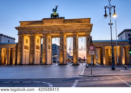 The Brandenburg Gate With The Tv Tower In The Back At Dawn, Seen In Berlin, Germany