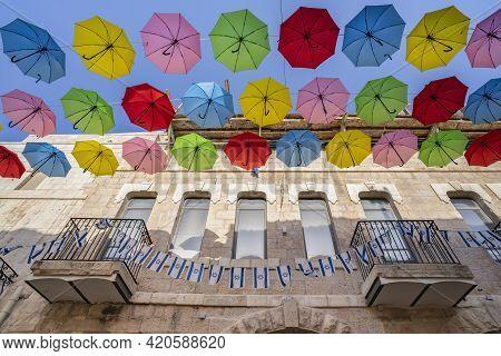 Jerusalem, Israel - April 29th, 2021:colorful Decorative Umbrellas And Israel's National Flags Hangi