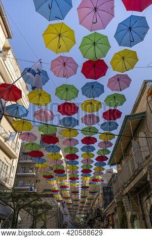 Jerusalem, Israel - April 29th, 2021:colorful Decorative Umbrellas Hanging Over A Jerusalem Street.
