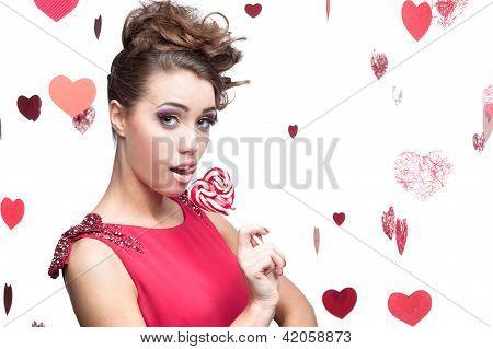 brunette woman holding lollipop