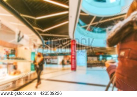 Customer Store Blurred Background. People Shopping In Modern Commercial Mall Center. Interior Of Ret