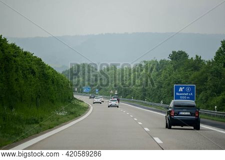 Stuttgart, Germany - June, 2016: A Lot Of Cars On The Autobahn Along The Forest.