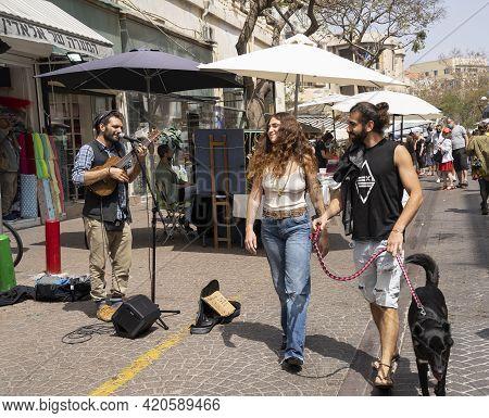 Tel Aviv, Israel - April 16th, 2021: A Street Musician Playing In A Tel Aviv, Israel, Street, On A S