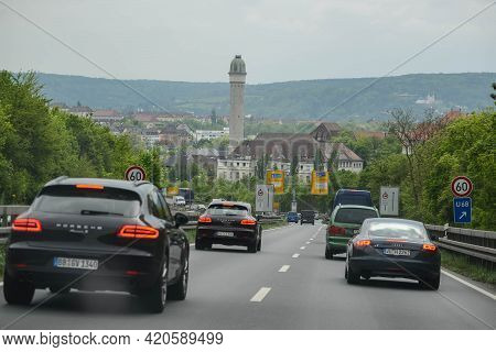 Stuttgart, Germany - June, 2016: An Autobahn Bend Along The Greenery Of A Bush In Germany. Light Fog