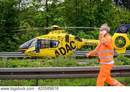 Stuttgart, Germany - June, 2016: A Rescue Helicopter On The Autobahn During An Accident