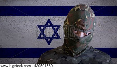 Militant Israel Angry Soldier With Green Camouflage Balaclava On Israeli Flag. Military Zionist Figh