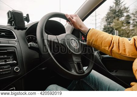 Cambridge Uk May 2021 Interior Of A Volkswagen Polo. Man Driving The Car On The Uk Roads, Steering W