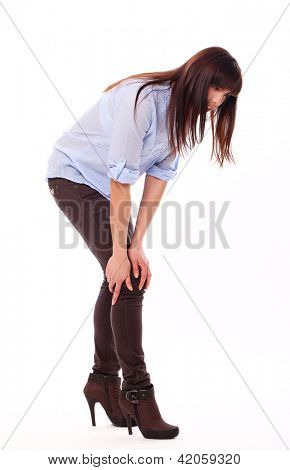 Beautiful caucasian woman feels pain isolated over white background