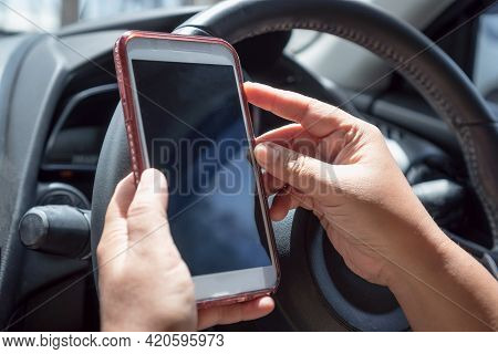 Driver Driving Car And Hands Using Smartphone Apps For Searching Maps Or Calling To Friend. Mockup S