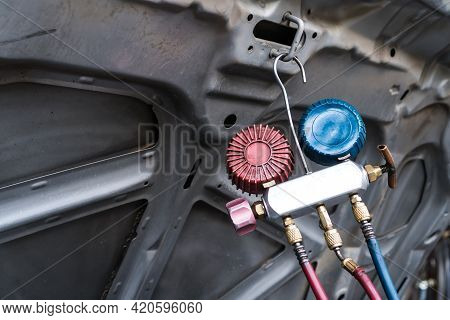 Monitor Tool On Mechanic Repair Car Fixing Air Condition In Garage Auto Monitor Pressure Engine For
