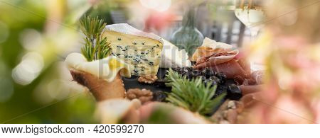 Plate With Tasty Starters And White Wine In Summer. Atmospheric Food Photography With Short Deep Of