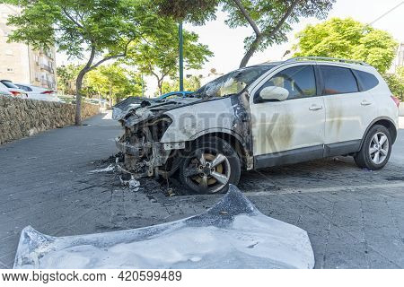 Burned Car Close Up. Car After The Fire, Crime Of Vandalism, Riots. Arson Car. Accident On The Road