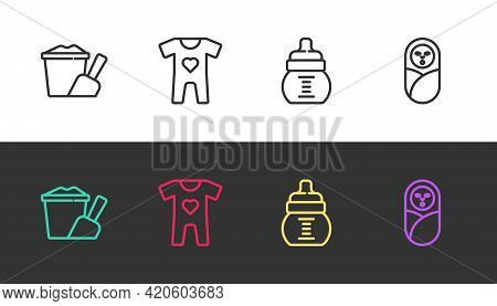 Set Line Sand In Bucket With Shovel, Baby Clothes, Bottle And Newborn Baby Infant Swaddled On Black