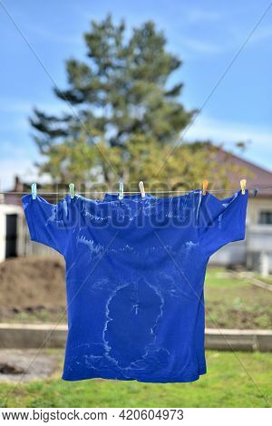 White Salty Sweat Stains On Blue Clothes