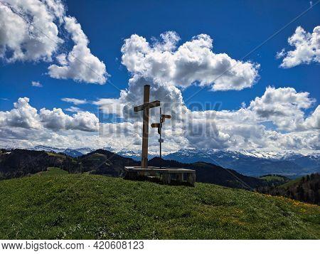 Summit Cross On The Beautiful Grass Hill Huettchopf In Zurich Oberland Switzerland. Nice View Of The