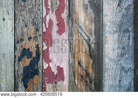 Peeling Paint On Distressed Old Wood With Vertical Pattern