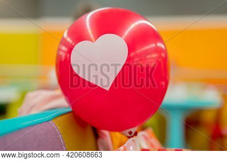 Red Air Balloon With Drawn White Heart On It. In Love. Relationship. Feelings. Celebrate. Celebratin